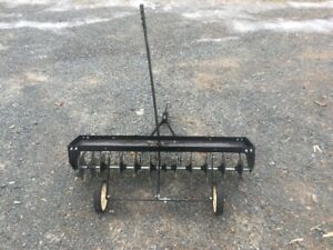 Spike Aerator & Lawn Sweeper selling as pair