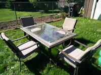 Glass patio table + 6 chairs