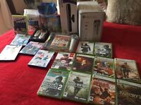 Xbox 360 plus Kinect - two controllers, battery pack headset and all Kinect and normal games shown
