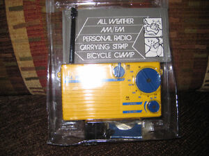 All Weather AM/FM Personal Radio, Carrying case, Bicycle Clamp