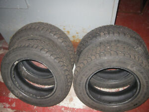 4 winter tires studded like new 175-65 r14 asking 350