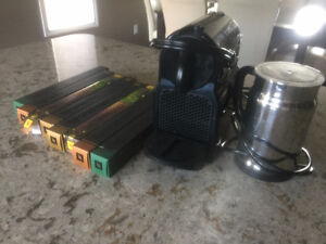 Brand new Nespresso Maker, Milk frother and coffee discs