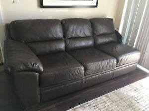 large part of real leather sectional in excellent condition