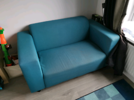 Teal coloured 2 seat sofa. Collection only