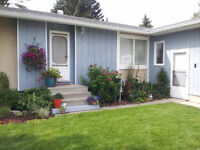 Bright, clean bungalow in Olds available August 15