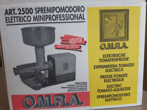 Tomato squeezer, electric, by OMRA