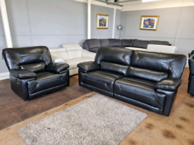 Real black leather recliner and swivel rocking sofa