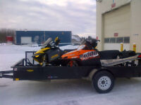 2 Sleds and Trailer - located in Fort Nelson