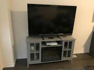 Sony 52 inch big Screen TV with fireplace unit.647-678-5618