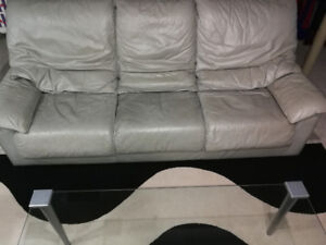 Leather couch, loveseat and glass top coffee table