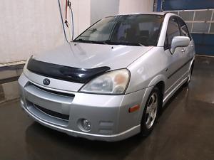 Suzuki aerio 2004 sport automatique économique 2.3L tres prope c