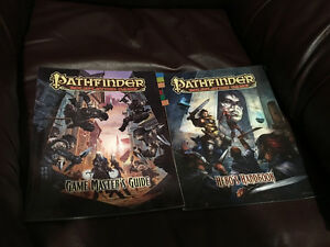 Large selection of Pathfinder RPG books with dice