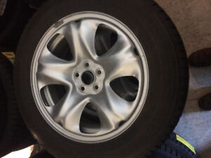 (Used one season) Winterforce tires and steel rims. 225/60/17