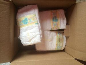 Pampers swaddlers newborn diapers/pack of 35 Windsor Region Ontario image 1