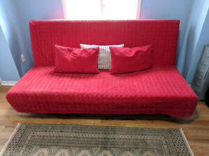 Ikea Beddinge 3 seat sofa bed. Red cover. Storage box.
