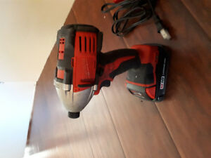 Brand New Milwaukee M18 Li-Ion Battery and used Impact Drill