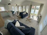 Double lodge with direct lake views, spacious decking, free facilities