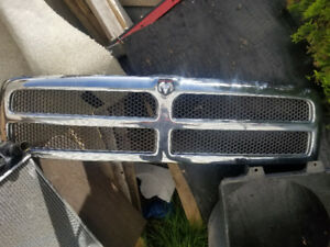 Grill with Hood Latch for a 96 Dodge Ram