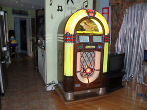 Wurlitzer jukebox. ( One more time ) avec 45's tours.Tres Rare.