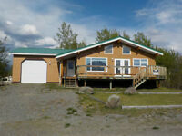 Custom Built family home in Atlin BC with amazing view