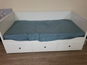 Twin Ikea bed with two mattresses.