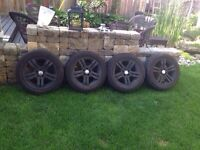 Set of 4 P205/55R16 tires on 16 inch rims