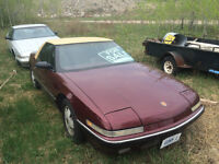 Two 1989 Buick Reattas (Silver and Burgundy)