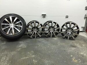 "Four Universal 16"" rims for sale."