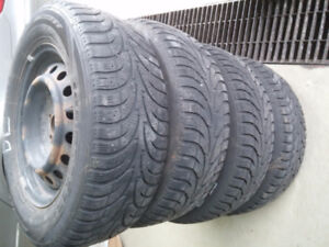 USED SNOW TIRES 15 inch WITH RIMS