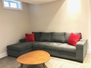 Large, grey L-shaped couch.