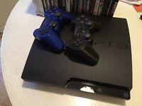 PlayStation 3  avec 2 manettes et 21 jeux