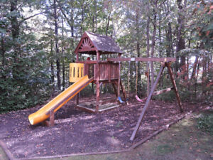 Solid Wood Play Structure with swings, sandbox, and slide