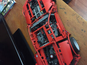Red car with moving pistons on engine