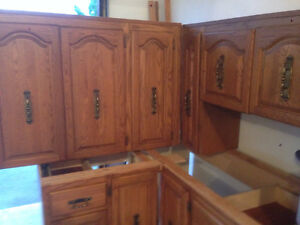 solid Oak Cabinets for sale staked inside my Garage