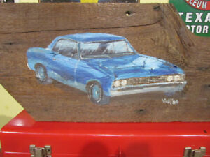Vintage tole painted 1967 Chevelle on barnboard.