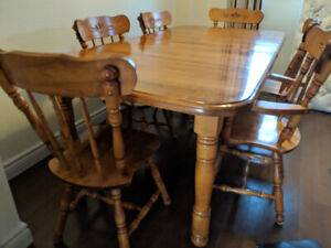 Large wooden dining room set with 6 chairs
