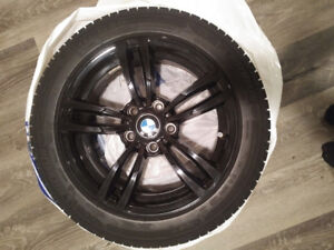 "Michelin X Ice winter tires 225/50R17 with 17"" BMW black rims"