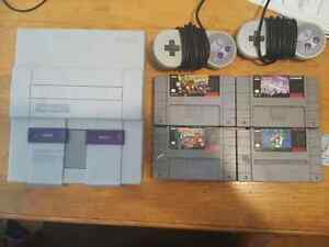 SNES + 2 controllers + 4 games (Bundle only)
