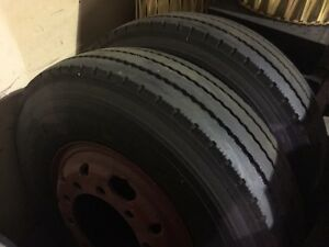 2. 10.00x20 tires and rims $100 for pair