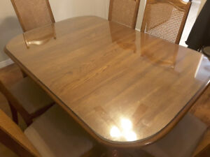 Solid oak table and 6 chairs with a glass top