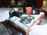 Cameras Konica & Yashica two SLR models with cases  lenses plus
