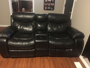 Real leather reclining couch and love seat