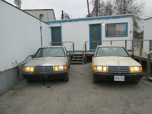 two Mercedes 190E cars