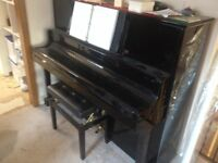 Pianos, delivery and tuning