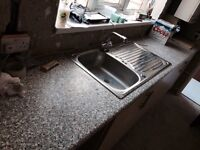 Kitchen sink, taps and work benches