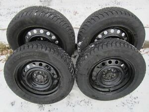 "Four 15"" studded snow tires excellent condition, on steel rims"