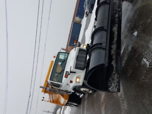 FREIGHTLINER WITH NEW HYDRAULIC ANGLE BLADES, V-BLADES AND BROOM