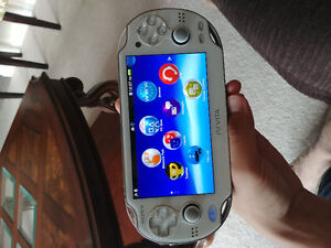 Sony PS Vita with 4 Games
