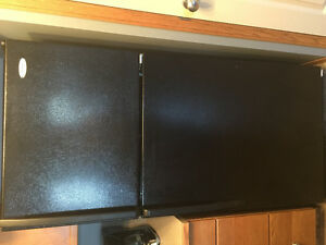 Black whirlpool fridge and stove excellent condition