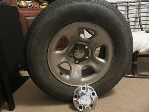 4 Dodge Ram stock rims with tires